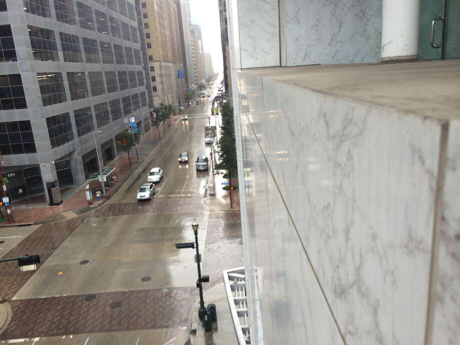 A nasty afternoon shower rolled into downtown Houston shortly after 2 p.m. Saturday afternoon. Photo: Bobby Blanchard, Houston Chronicle