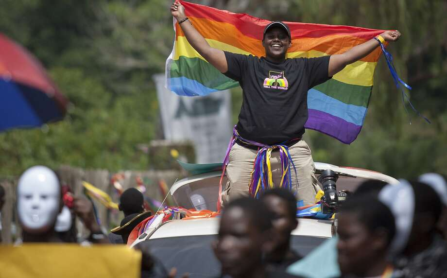 Ugandans take part in the nation's third annual pride parade in Entebbe. Photo: Rebecca Vassie, Associated Press