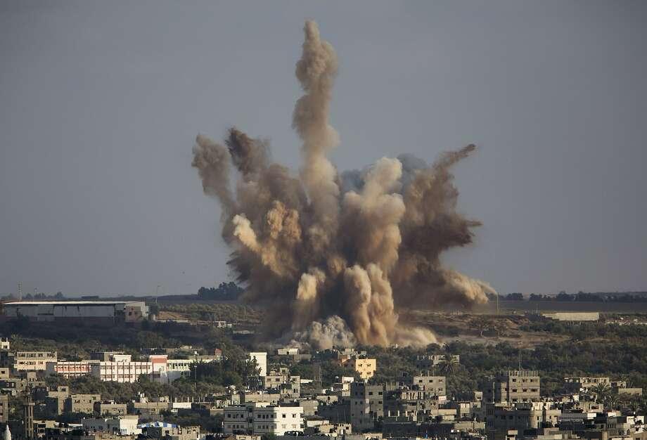 An Israeli air strike blasts Gaza City. Cross-border attacks went on with peace negotiations on hold. Photo: Dusan Vranic, Associated Press