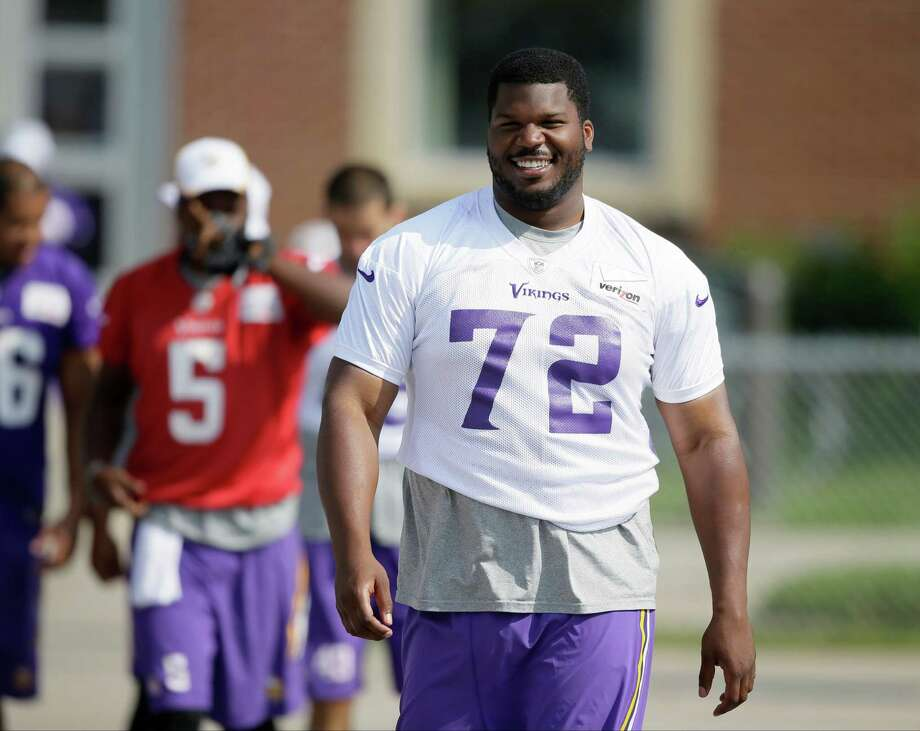 Minnesota Vikings defensive tackle Kheeston Randall (No. 78) walks to the field before a training camp practice, Saturday, Aug. 2, 2014, in Mankato, Minn. The former Kelly Catholic star was released by the VIkings on Monday. (AP Photo/Charlie Neibergall) Photo: Charlie Neibergall, STF / AP