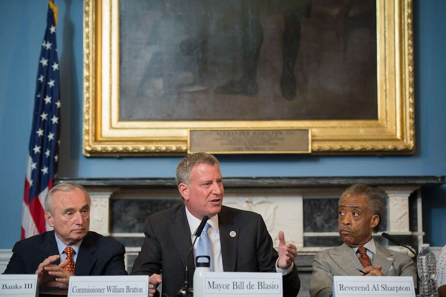Police Commissioner William Bratton (left), Mayor Bill de Blasio and the Rev. Al Sharpton last month. Photo: Bob Bennett, Associated Press