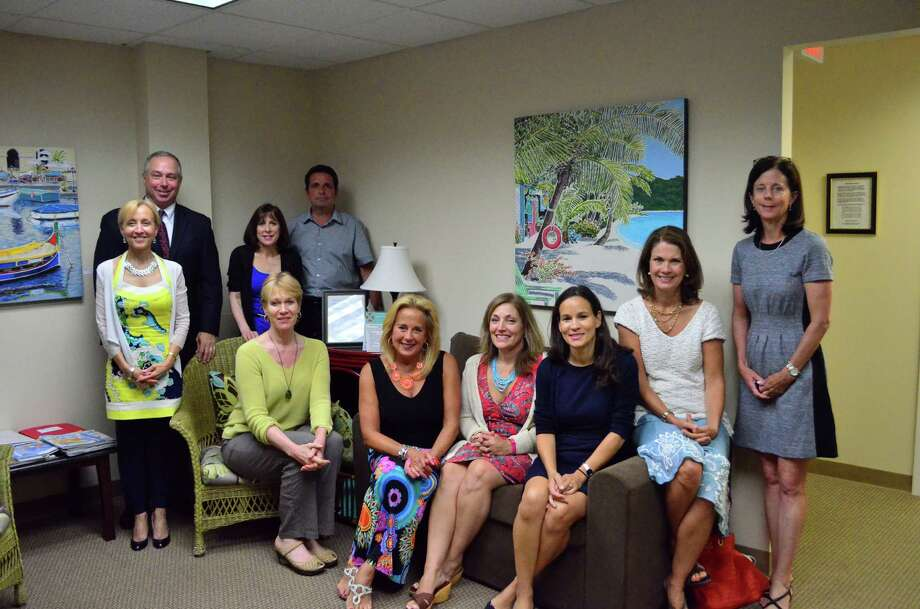 Some of the practitioners and staff from Life Solution Center include Maud Percell, from left, Paul Bernstein, Joanne Labs, Rick Labella, Lisa Gardner, Erica Jensen, Laura VanRiper, Sandy Gomez, Catherine Horan and Victoria Thomas. Photo: Megan Spicer / Darien News