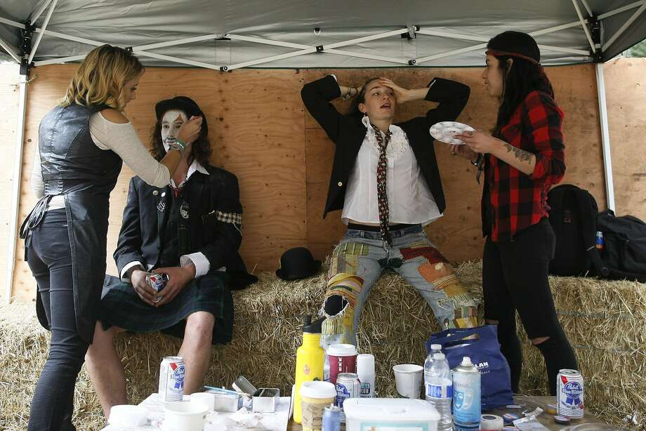 Left to right, Sarita Bull, Brian Ferraro, Casey Thorne and Silvia Bull prepare for a performance with Doctor Flotsam's Hell Brew Review at Outside Lands on Saturday, Aug. 9, 2014 in San Francisco, Calif. The festival featured a variety of acts from Tom Petty to Macklemore. Photo: James Tensuan, The Chronicle