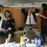 Left to right, Sarita Bull, Brian Ferraro, Casey Thorne and Silvia Bull prepare for a performance with Doctor Flotsam's Hell Brew Review at Outside Lands on Saturday, Aug. 9, 2014 in San Francisco, Calif. The festival featured a variety of acts from Tom Petty to Macklemore.