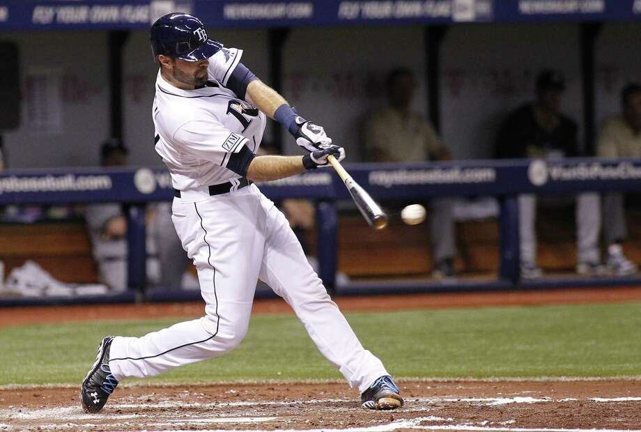 ST. PETERSBURG, FL - JULY 29:  Curt Casali #59 of the Tampa Bay Rays hits a single off of pitcher Matt Garza of the Milwaukee Brewers during the third inning of a game on July 29, 2014 at Tropicana Field in St. Petersburg, Florida. Photo: Brian Blanco, Getty Images / 2014 Getty Images