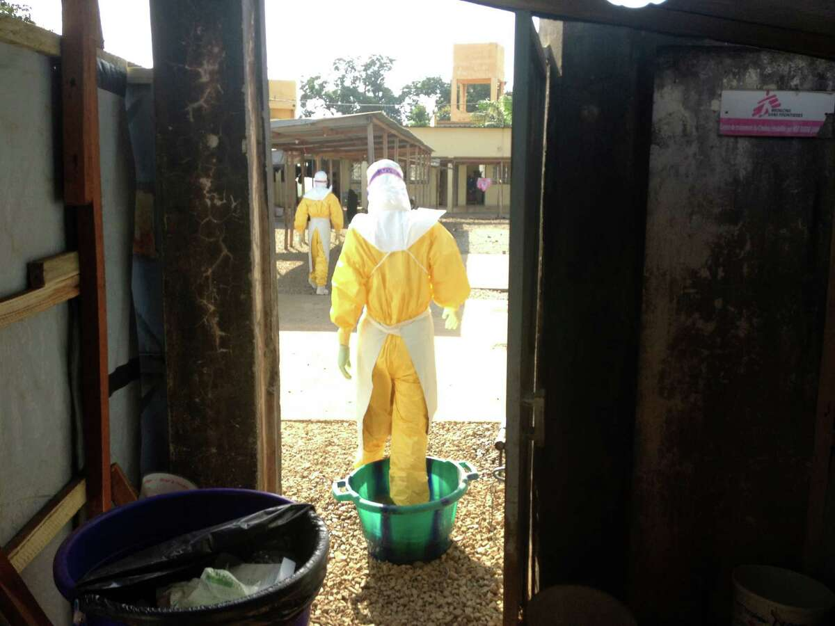 In Guinea earlier this year, Doctors Without Borders staff prepared to treat Ebola patients.