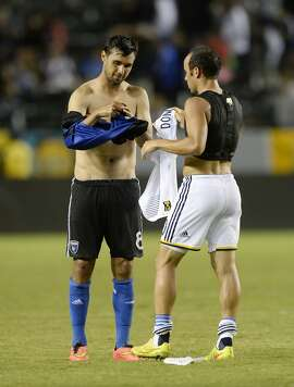 CARSON, CA - AUGUST 8: Landon Donovan #10 of the Los Angeles Galaxy exchanges his shirt with Chris Wondolowski #8 of the San Jose Earthquakes at the conclusion of their soccer match at the StubHub Center on August 8, 2014, in Carson, California. Donovan is retiring at the conclusion of  the 2014 MLS season. (Photo by Kevork Djansezian/Getty Images)