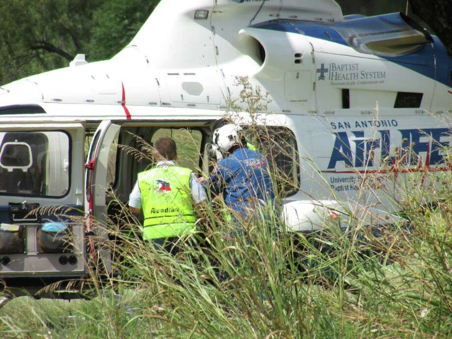 Medics load one child and one adult in two AirLife choppers after they were injured in an accident involving a donkey-drawn carriage and a pickup truck in Southwest Bexar County on Saturday, Aug. 9, 2014. They were flown to University Hospital in San Antonio for treatment. Photo: Mark D. Wilson/San Antonio Express-News