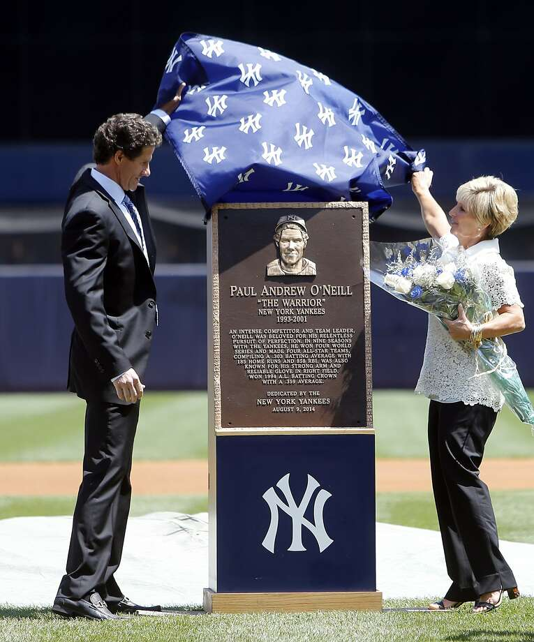 Paul O'Neill and wife Nevalee unveil his plaque that will be displayed in the Yankees' Monument Park. Photo: Jason DeCrow, Associated Press