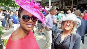 Margot Barnett, left, of Nassau, Bahamas, and Diana Ryan of Saratoga Springs sport perfect examples of a Saratoga hat at Saratoga Race Course Saturday August 9, 2014, in Saratoga Springs, NY.  (John Carl D'Annibale / Times Union)