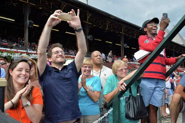 Fans cheer and photograph their favorite jockeys at Saratoga Race Course Saturday August 9, 2014, in Saratoga Springs, NY.  (John Carl D'Annibale / Times Union) Photo: John Carl D'Annibale / 10028088A