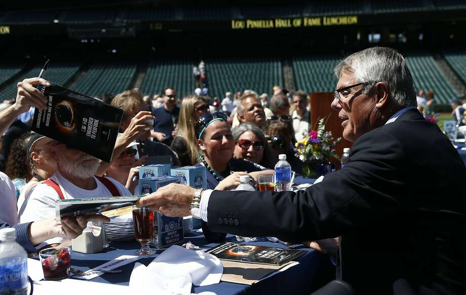 Former Mariners manager Lou Piniella signs autographs for fans gathered at a luncheon at Safeco Field. Photo: Mark Harrison, Associated Press
