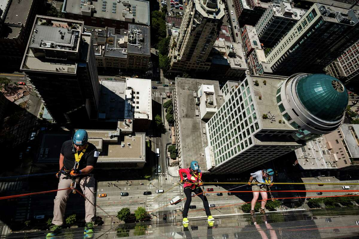 Nearly 100 brave individuals rappelled down the 40 stories and 490 feet of Seattle's 1000 Second Avenue Building as part of the Over The Edge fundraiser to benefit Special Olympics Washington on Saturday, Aug. 9, 2014, in Seattle. Participants are guaranteed a spot as long as they raise a minimum of $1,000 -- the amount it costs to support nearly two Special Olympics athletes for an entire year. The event continues Sunday.