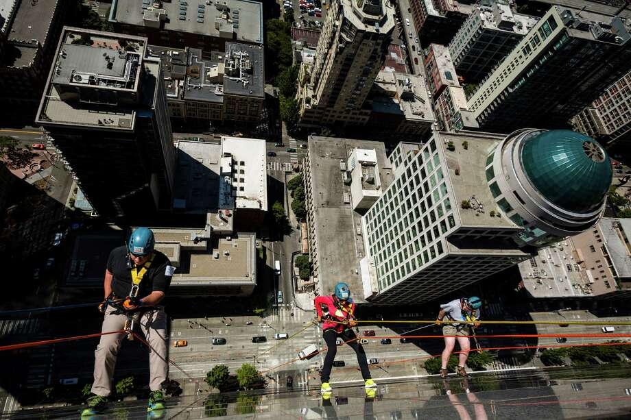 Nearly 100 brave individuals rappelled down the 40 stories and 490 feet of Seattle's 1000 Second Avenue Building as part of the Over The Edge fundraiser to benefit Special Olympics Washington on Saturday, Aug. 9, 2014, in Seattle. Participants are guaranteed a spot as long as they raise a minimum of $1,000 -- the amount it costs to support nearly two Special Olympics athletes for an entire year. The event continues Sunday. Photo: JORDAN STEAD, SEATTLEPI.COM / SEATTLEPI.COM