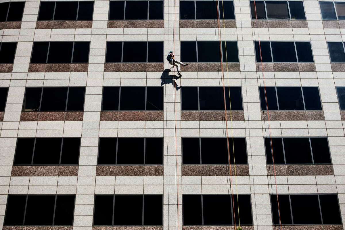 Nearly 100 brave individuals rappelled down the 40 stories.