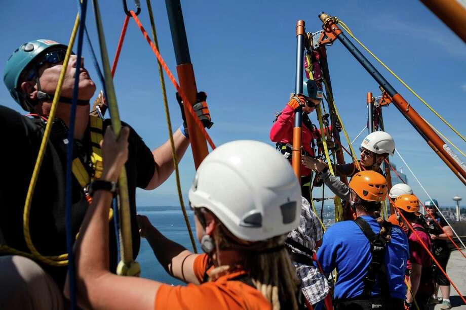 Participants prepare to rappel down the 40 stories. Photo: JORDAN STEAD, SEATTLEPI.COM / SEATTLEPI.COM