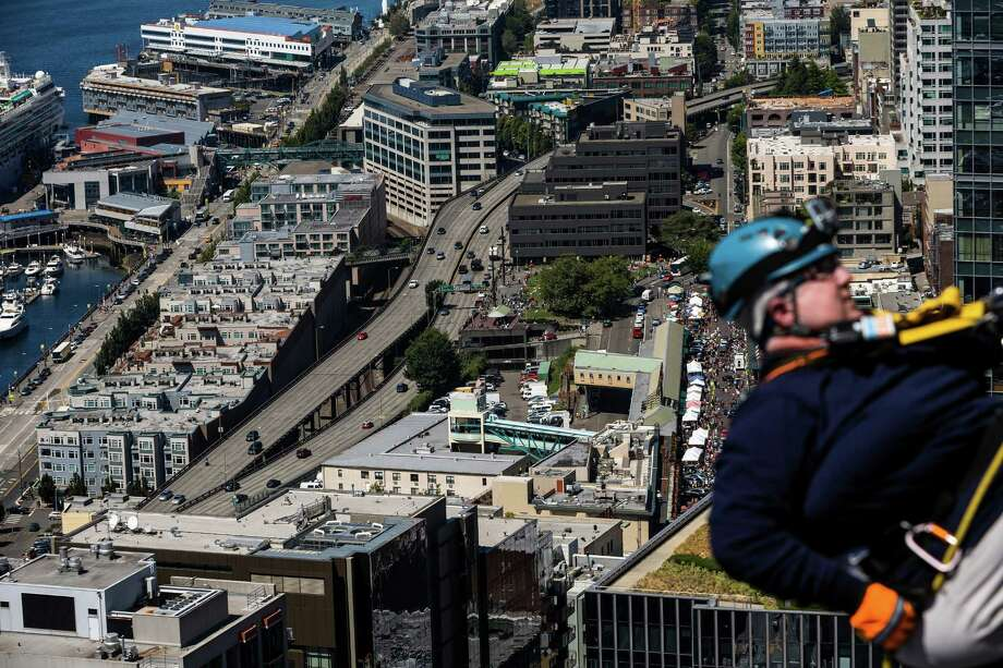 Nearly 100 brave individuals rappelled down the 40 stories. Photo: JORDAN STEAD, SEATTLEPI.COM / SEATTLEPI.COM