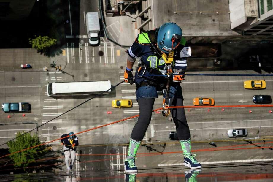 Maria Rivera cautiously descends. Photo: JORDAN STEAD, SEATTLEPI.COM / SEATTLEPI.COM