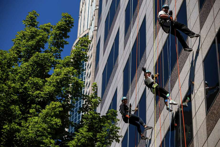 Nearly 100 brave individuals rappelled down the 40 stories and 490 feet. Photo: JORDAN STEAD, SEATTLEPI.COM / SEATTLEPI.COM
