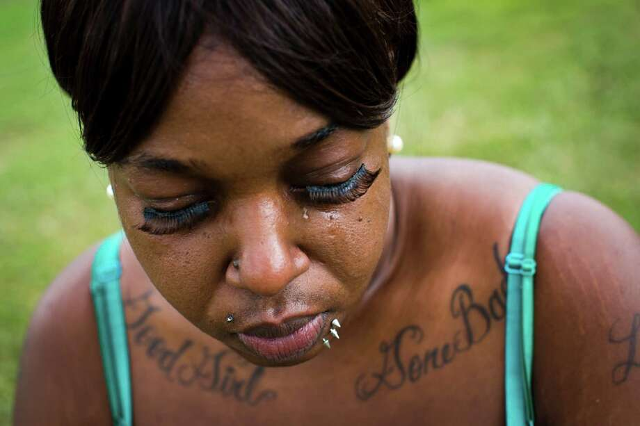 Canndus Lewis mourns her daughter, Forever Donatto, only 11 months old when she died in a drive-by shooting in 2012. The case remains unsolved. Photo: Marie D. De Jesus, Staff / © 2014 Houston Chronicle