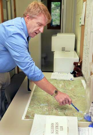 Morehouse town supervisor William Farber points out the area's major streams on a topographic map Tuesday Aug. 5, 2014, at Town Hall in Morehouse, N.Y.  (John Carl D'Annibale / Times Union) Photo: John Carl D'Annibale / 00027999A
