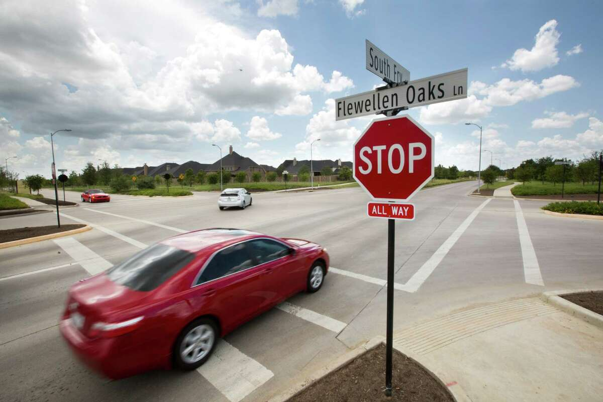 A vehicle advances to cross the four-way stop of Flewellen Oaks Lane and South Fry Road in Fulshear. The ample intersection has raised questions of safety for the young members of the community walking to the nearby elementary school.
