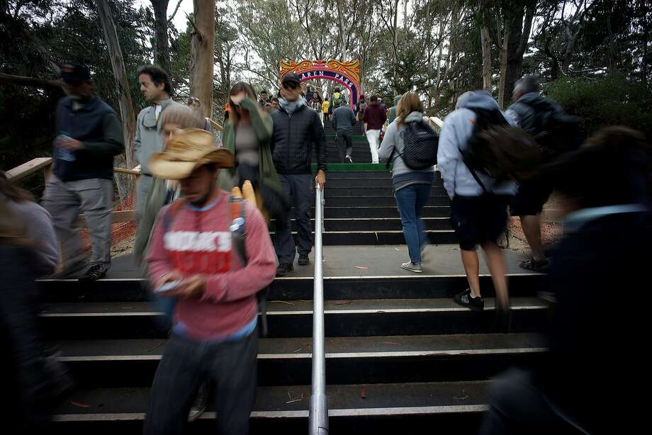 Outside Land attendees make their way through Golden Gate Park on Saturday, Aug. 9, 2014 in San Francisco, Calif. The festival featured a variety of acts from Tom Petty to Macklemore. Photo: James Tensuan, The Chronicle
