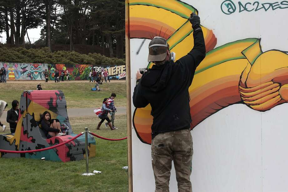 Aden Catalani paints a mural at Outside Lands in Golden Gate Park on Saturday, Aug. 9, 2014 in San Francisco, Calif. The festival featured a variety of acts from Tom Petty to Macklemore. Photo: James Tensuan, The Chronicle