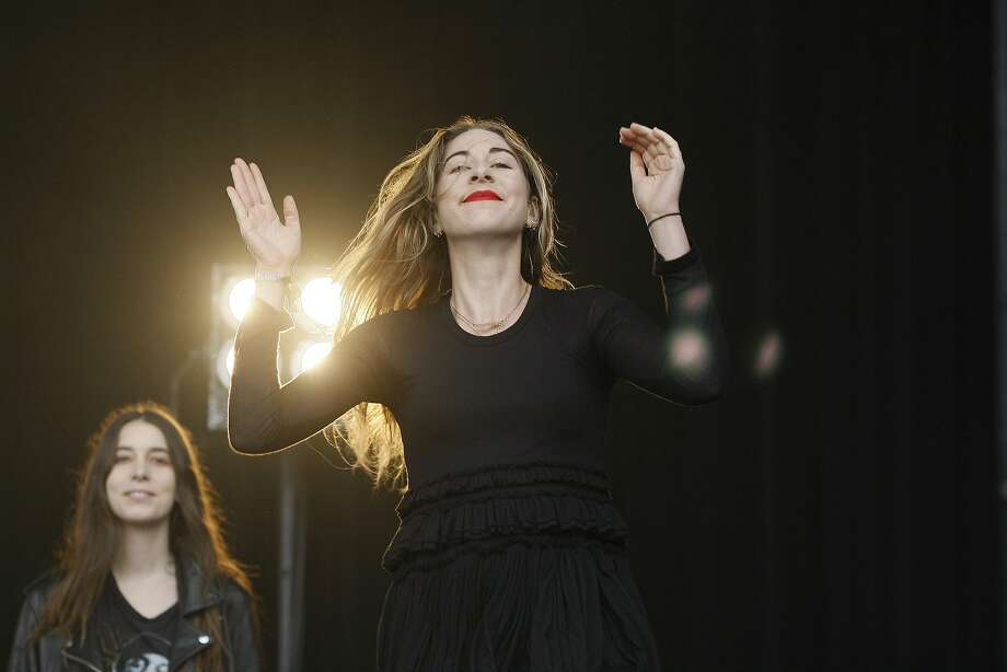 Este Arielle Haim of Haim greets the crowd at Outside Lands on Saturday, Aug. 9, 2014 in San Francisco, Calif. The festival featured a variety of acts from Tom Petty to Macklemore. Photo: James Tensuan, The Chronicle