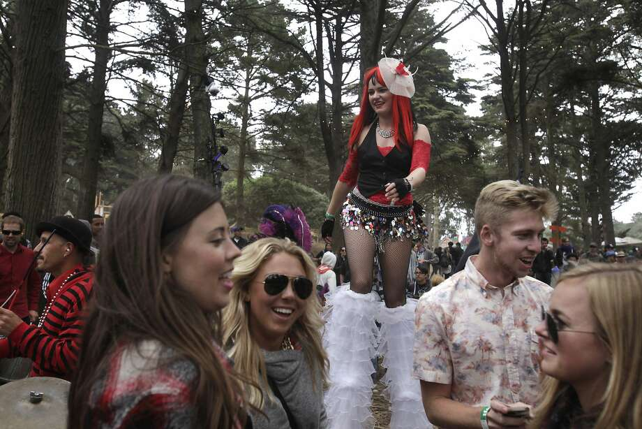 People dance along with members of the Samba Stilt Circus, including Dalyte Kodzis (on stilts) during Outside Lands music festival August 9, 2014 in Golden Gate Park in San Francisco, Calif. Photo: Leah Millis, The Chronicle