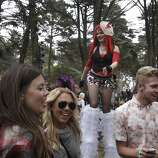 People dance along with members of the Samba Stilt Circus, including Dalyte Kodzis (on stilts) during Outside Lands music festival August 9, 2014 in Golden Gate Park in San Francisco, Calif.