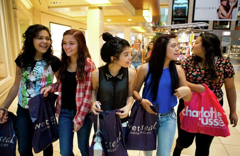 Shopping for back-to-school clothes was a group effort Saturday at the Galleria for some teens, including, from left, Catarina Rodriguez, Margaret Reeder, Ruth Trejo, Iridian Gomez and Faviola Rodriguez. Photo: Marie D. De Jesus, Staff / © 2014 Houston Chronicle