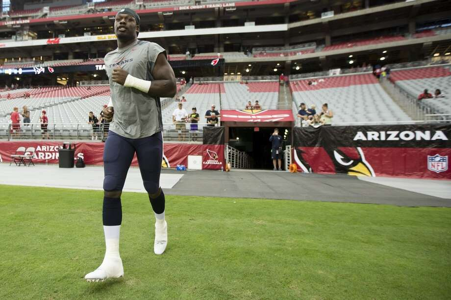 Houston Texans linebacker Jadeveon Clowney jogs onto the field to warm up before an NFL pre-season football game against the Arizona Cardinals at University of Phoenix Stadium Saturday, Aug. 9, 2014, in Glendale, Ariz. ( Brett Coomer / Houston Chronicle ) Photo: Brett Coomer, Houston Chronicle