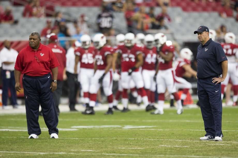 Houston Texans defensive coordinator Romero Crennel, left, and Texans head coach Bill O'Brien stand on the field before an NFL pre-season football game against the Arizona Cardinals at University of Phoenix Stadium Saturday, Aug. 9, 2014, in Glendale, Ariz. ( Brett Coomer / Houston Chronicle ) Photo: Brett Coomer, Houston Chronicle
