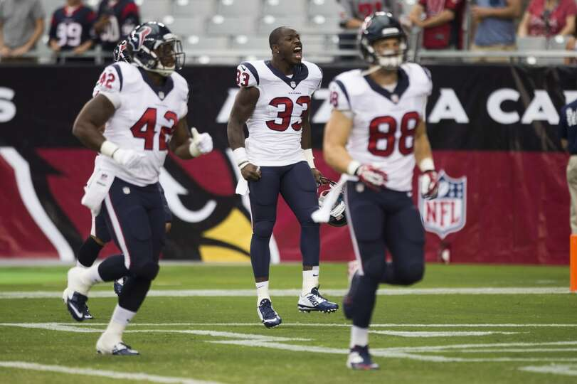 Houston Texans running back Andre Brown (33) yells as he comes onto the field before an NFL pre-seas