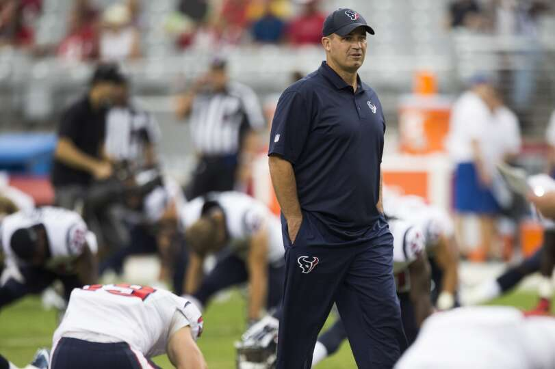 Houston Texans head coach Bill O'Brien walks across the field before an NFL pre-season football game