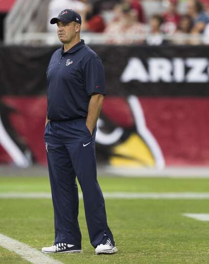 Houston Texans head coach Bill O'Brien stands on the field before an NFL pre-season football game ag