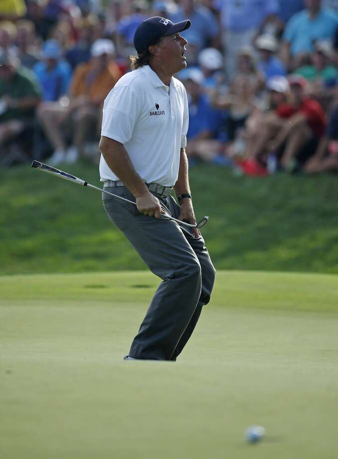 Phil Mickelson grimaces after just missing a 45-footer for eagle on the 18th hole. Nonetheless, starting the final round of the PGA Championship just three shots behind the leader isn't bad. Photo: Mike Groll, Associated Press