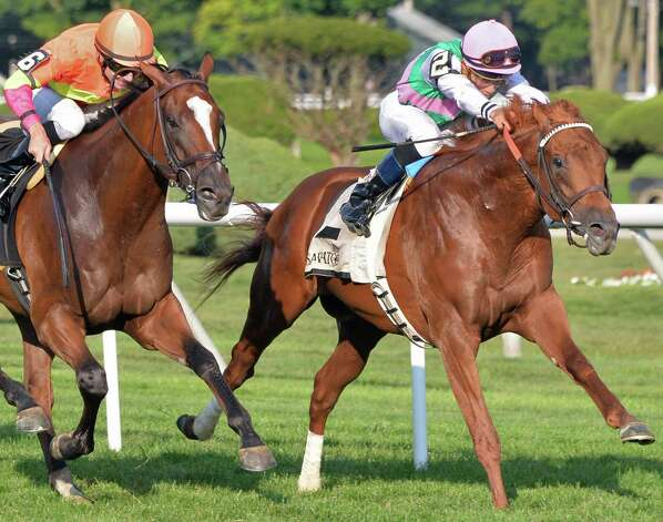 Seek Again and Joel Rosario, right, on their way to winning the Fourstardave Handicap at Saratoga Race Course Saturday August 9, 2014, in Saratoga Springs, NY.   At left is second place finisher Grand Arch with David Moran up.  (John Carl D'Annibale / Times Union) Photo: John Carl D'Annibale / 10028088A