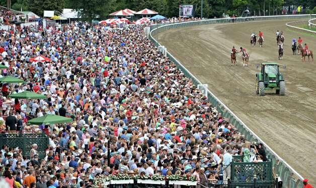 A large crowd on hand for Saturday's race card at  Saratoga Race Course August 9, 2014, in Saratoga Springs, NY.  (John Carl D'Annibale / Times Union) Photo: John Carl D'Annibale / 10028088A