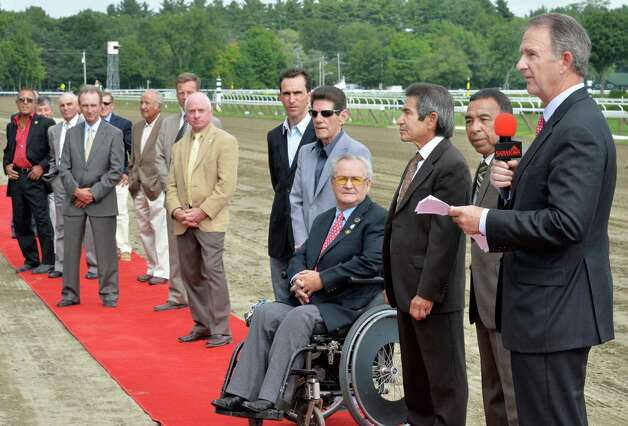 "NYRA CEO and President Chris Kay, right, is joined by some of of the greatest riders in the history of Thoroughbred racing for the first-ever ""Jockey Legends Day"" to benefit the Permanently Disabled Jockeys Fund at Saratoga Race Course Saturday August 9, 2014, in Saratoga Springs, NY.  (John Carl D'Annibale / Times Union) Photo: John Carl D'Annibale / 10028088A"