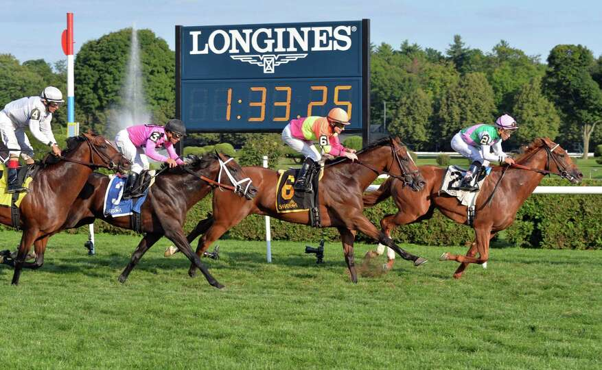 Seek Again and Joel Rosario, right, win the Fourstardave Handicap at Saratoga Race Course Saturday A