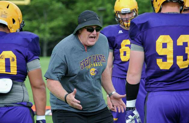 UAlbany's new football coach Greg Gattuso, center, works with his players during practice on Thursday, Aug. 7, 2014 in Albany, N.Y. (Lori Van Buren / Times Union) Photo: Lori Van Buren / 00028065A