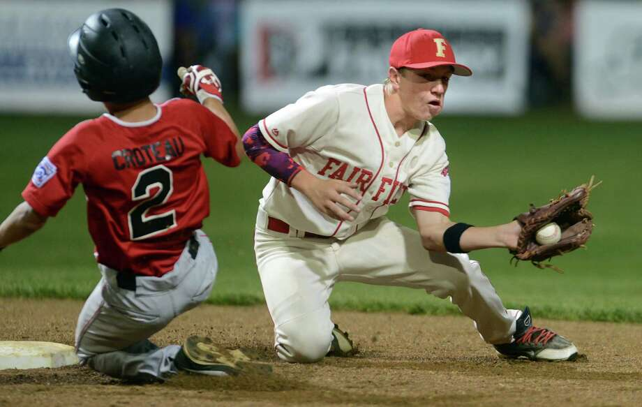 Fairfield American's Brian Howell turns to tag Cumberland American's John Reynolds as he slides to 2nd base during the New England Regional Little League championship game Saturday, Aug. 9, 2014, at Breen Field in Bristol, Conn. Photo: Autumn Driscoll / Connecticut Post
