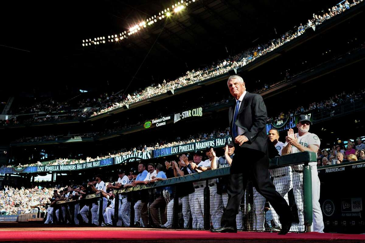 Cheered on by thousands, Lou Piniella, the winningest manager in Seattle Mariners history, takes to the field to be honored as the eighth member of the Mariners Hall of Fame during a special pregame ceremony Saturday, Aug. 9, 2014, at Safeco Field in Seattle. The first 20,000 fans through the ballpark's gates received a Lou Piniella Hall of Fame bobblehead, and the Mariners took on the Chicago White Sox following the ceremony.