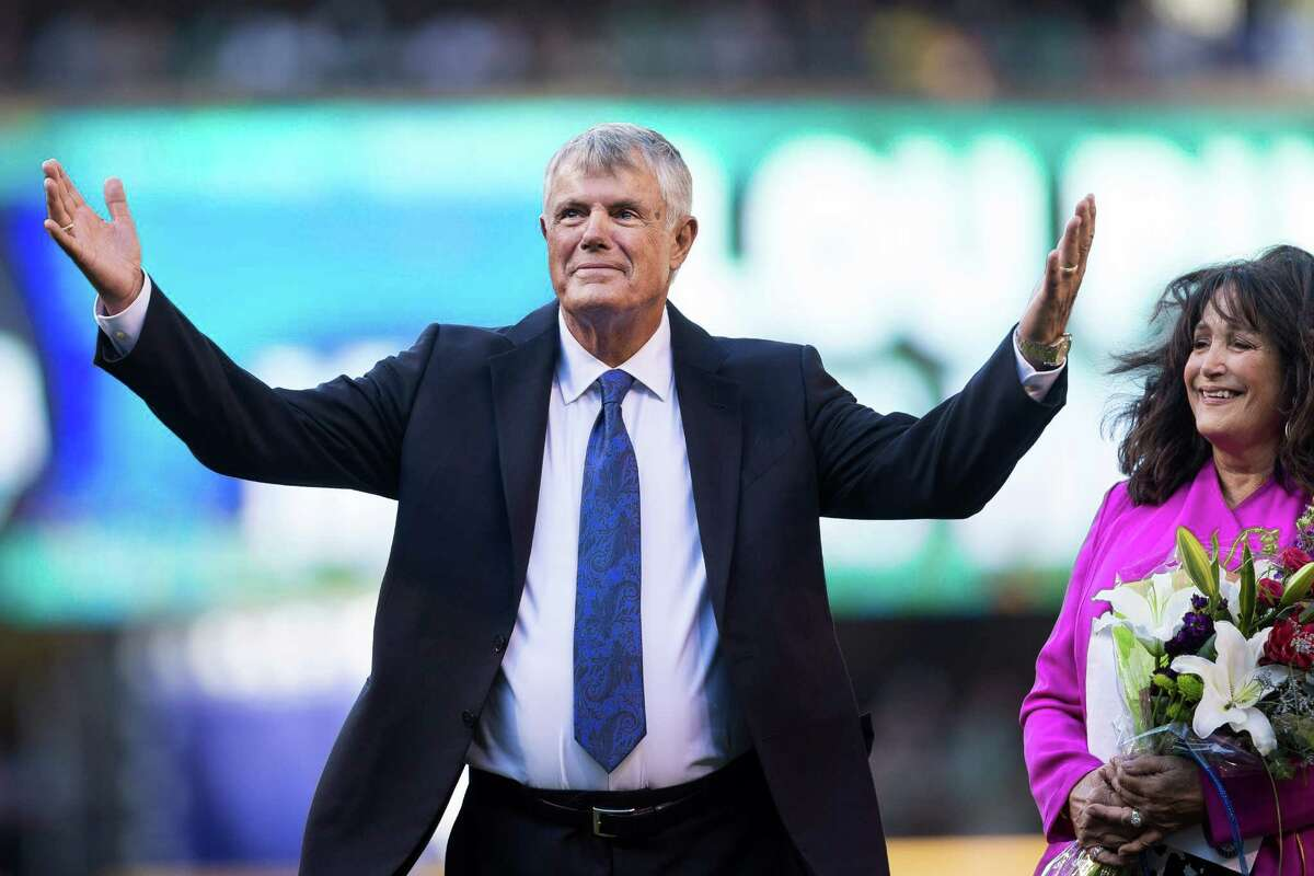 Lou Piniella, alongside his wife, Anita Piniella, right, takes to the field to be honored.