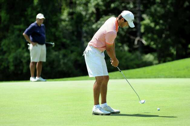 Austin Teal of Loudonville, right, putts as Dan Russo of Hagaman, left, watches during Capital Stroke Play on Saturday, Aug. 9, 2014, at Schuyler Meadows Club in Loudonville, N.Y. (Cindy Schultz / Times Union) Photo: Cindy Schultz / 10028081A