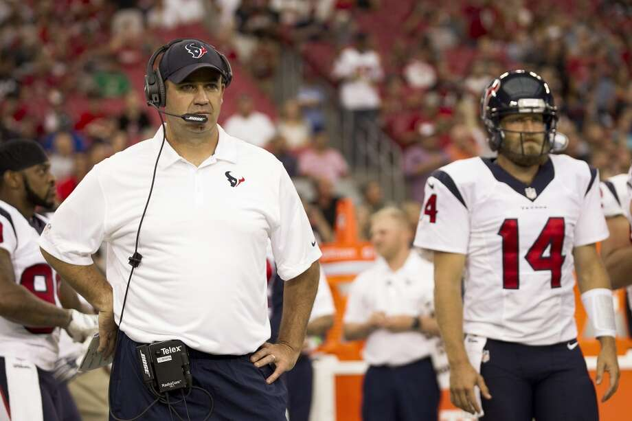 Houston Texans head coach Bill O'Brien, left, stands next to quarterback Ryan Fitzpatrick (14) on the sidelines before the first quarter of an NFL pre-season football game at University of Phoenix Stadium Saturday, Aug. 9, 2014, in Glendale, Ariz. ( Brett Coomer / Houston Chronicle ) Photo: Brett Coomer, Houston Chronicle