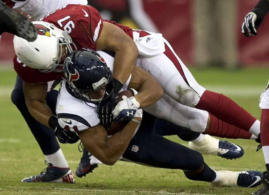Arizona Cardinals outside linebacker Lorenzo Alexander (97) stops Houston Texans running back Jonathan Grimes (41) at the line of scrimmage during the second quarter of an NFL pre-season football game at University of Phoenix Stadium Saturday, Aug. 9, 2014, in Glendale, Ariz. ( Brett Coomer / Houston Chronicle ) Photo: Brett Coomer, Houston Chronicle
