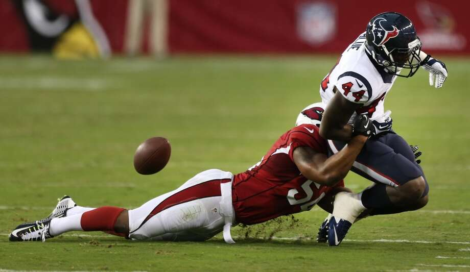 Arizona Cardinals inside linebacker Kenny Demens (54) breaks up a pass intended for Houston Texans running back Alfred Blue (44) during the second quarter of an NFL pre-season football game at University of Phoenix Stadium Saturday, Aug. 9, 2014, in Glendale, Ariz. ( Brett Coomer / Houston Chronicle ) Photo: Brett Coomer, Houston Chronicle